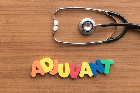 adjuvant: adjuvant colorful word on the wooden background