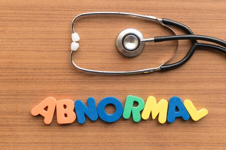 abnormal: abnormal colorful word on the wooden background Stock Photo