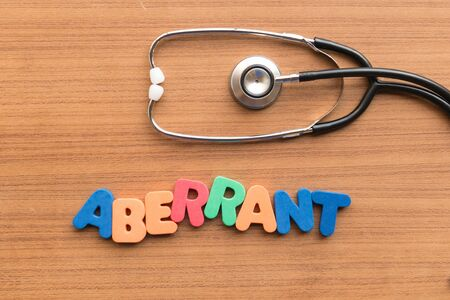 aberrant: aberrant colorful word on the wooden background