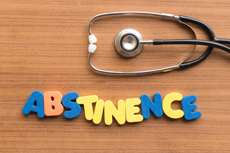 abstinence: abstinence colorful word on the wooden background Stock Photo