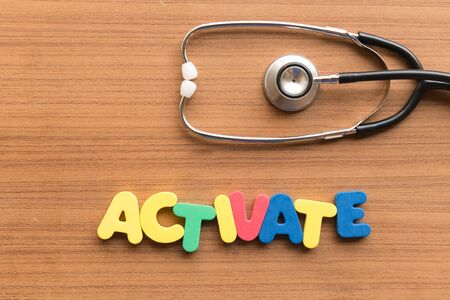 activate: activate colorful word on the wooden background Stock Photo