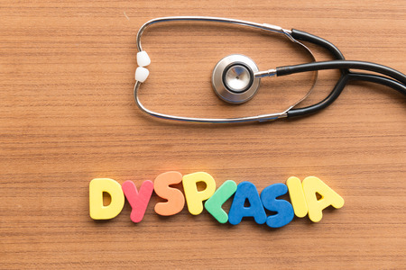 dysplasia: dysplasia colorful word on the wooden background Stock Photo