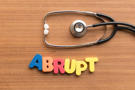 abrupt: abrupt colorful word on the wooden background