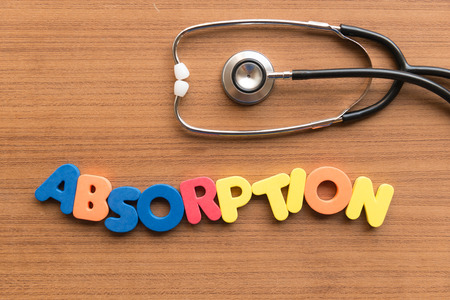 absorption: absorption colorful word on the wooden background