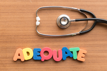 adequate: adequate colorful word on the wooden background