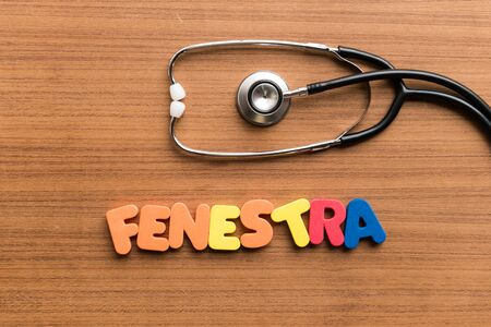 smal: fenestra colorful word on the wooden background with stethoscope Stock Photo