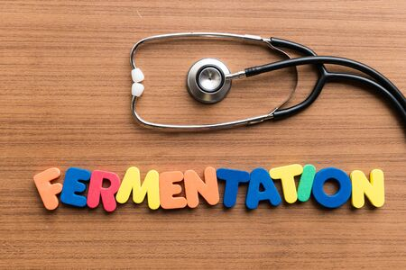 fermentation: fermentation colorful word on the wooden background with stethoscope