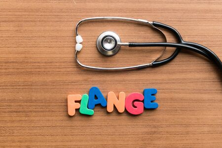 flange: flange colorful word on the wooden background with stethoscope Stock Photo