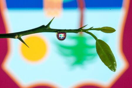 indies: West Indies flag through water drop