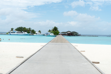 palapa: overwater bungalows boardwalk of the Maldives Editorial