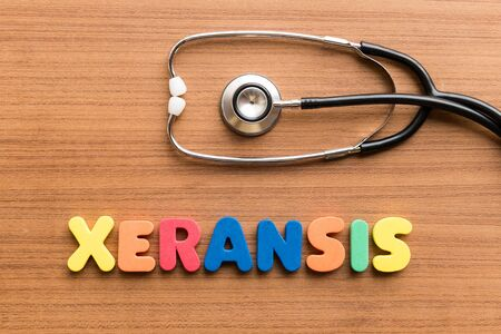 gradual: xeransis colorful word on the wooden background with stethoscope