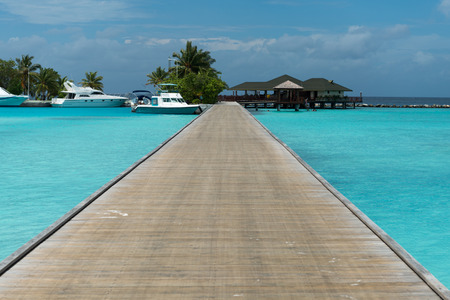 bungalows: overwater bungalows boardwalk of the Maldives Editorial