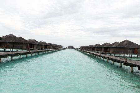 palapa: Male, Maldives - February 18, 2016: Maldives beautiful water Villa piles on the water in paradise island