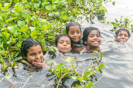 children pond: Munshigonj, Bangladesh - July 29, 2016: Children taking bath in a pond to beat the heat of scorching sun, on July 29, 2016 in in the village of Munshogonj, bangladesh.