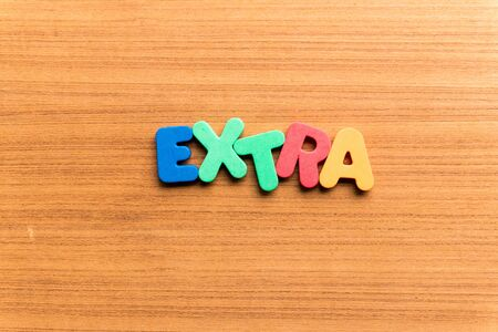 extra: extra colorful word on the wooden background