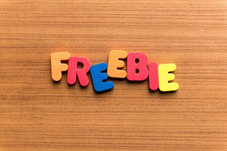 freebie: freebie colorful word on the wooden background Stock Photo
