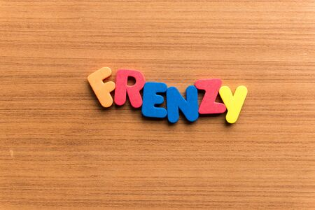 frenzy: frenzy colorful word on the wooden background Stock Photo