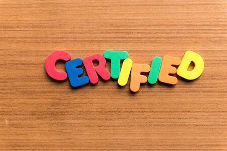 certified: certified colorful word on the wooden background