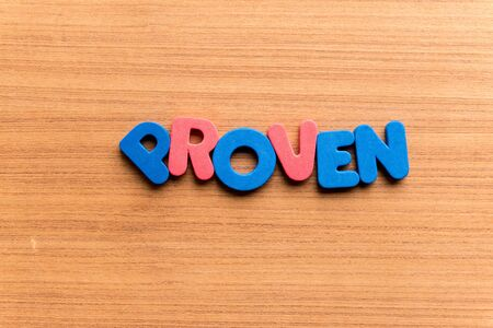 proven: proven colorful word on the wooden background