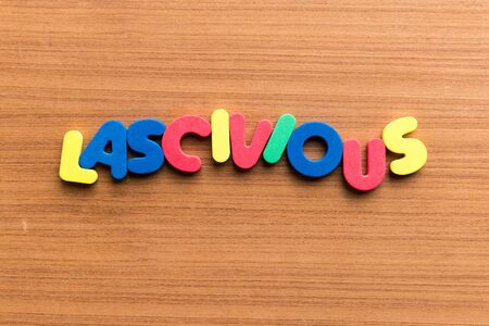 lascivious colorful word on the wooden background