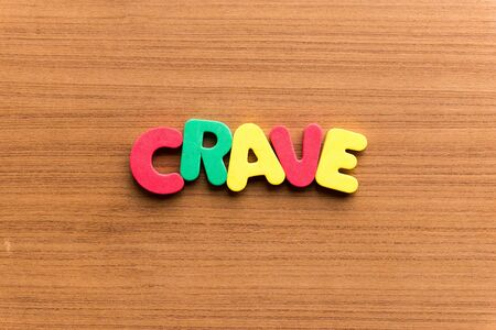 crave: crave colorful word on the wooden background