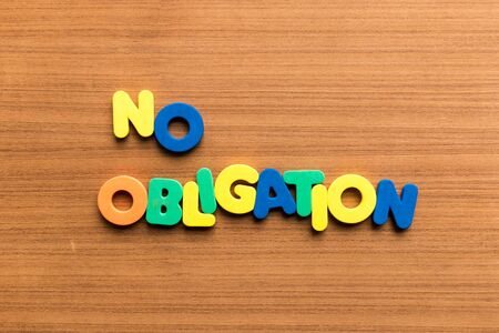 obligation: no obligation colorful word on the wooden background