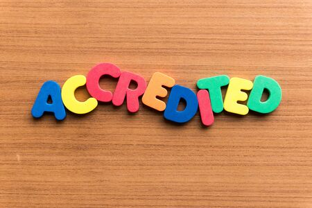 accredited: accredited colorful word on the wooden background Stock Photo