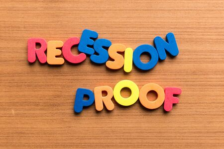 proof: recession proof colorful word on the wooden background Stock Photo
