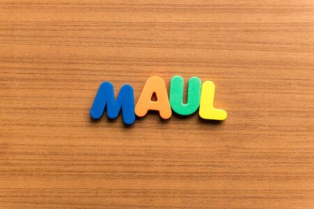 maul: maul colorful word on the wooden background