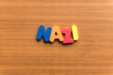 nazi: nazi colorful word on the wooden background Stock Photo