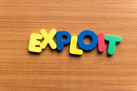 exploit: exploit colorful word on the wooden background Stock Photo