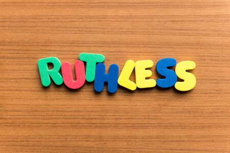 ruthless: ruthless colorful word on the wooden background Stock Photo