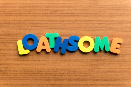 loathsome: loathsome colorful word on the wooden background