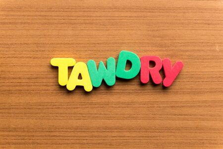 tawdry colorful word on the wooden background Stock Photo