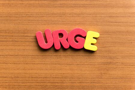 urge: urge colorful word on the wooden background