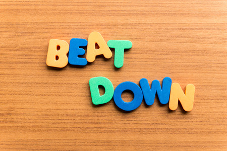 down beat: beat down colorful word on the wooden background