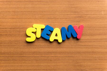 steamy: steamy colorful word on the wooden background Stock Photo