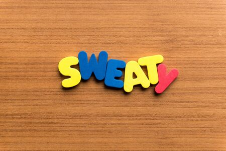 sweaty: sweaty colorful word on the wooden background Stock Photo