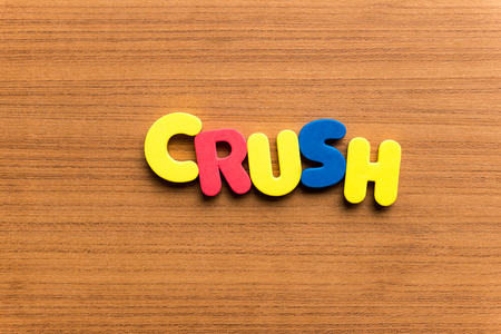 crush on: crush colorful word on the wooden background Stock Photo