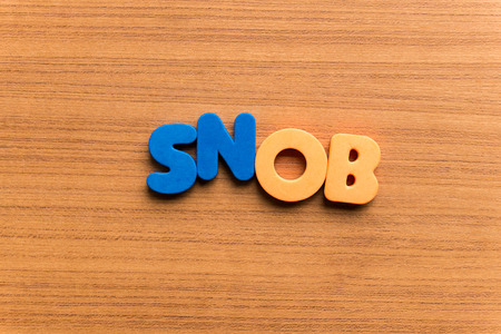 snob: snob colorful word on the wooden background