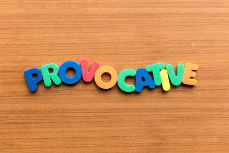 provocative: provocative colorful word on the wooden background Stock Photo