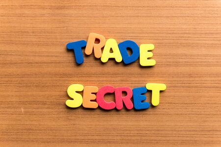 trade secret: trade secret colorful word on the wooden background