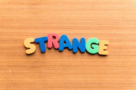 aberrant: strange colorful word on the wooden background Stock Photo