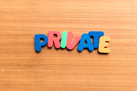 clandestine: private colorful word on the wooden background Stock Photo