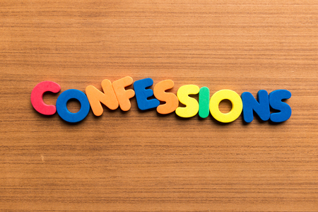 assertion: confessions colorful word on the wooden background