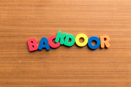 backdoor: backdoor colorful word on the wooden background colorful word on the wooden background