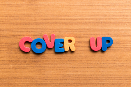 cover up: cover up colorful word on the wooden background Stock Photo