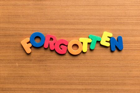 forgot: forgotten colorful word on the wooden background Stock Photo