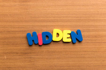 abstruse: hidden colorful word on the wooden background