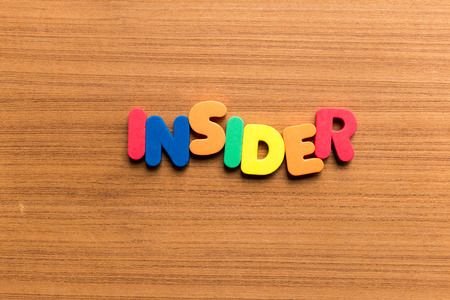 insider: insider colorful word on the wooden background